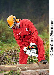 Lumberjack Worker With Chainsaw In The Forest - Lumberjack...