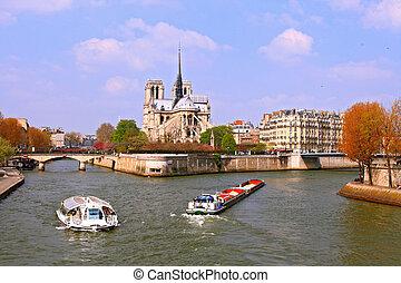 Passenger cruise at Cathedral Notre Dame, river Seine Paris...