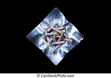 Decorated silver ashtray with cigarette butts isolated on...