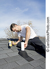 Roof Repair - Roofer repairing leaks around vent pipes on...