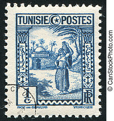 Arab Woman - TUNISIA - CIRCA 1936: stamp printed by Tunisia,...
