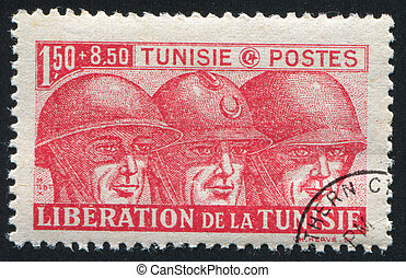 Soldiers - TUNISIA - CIRCA 1943: stamp printed by Tunisia,...