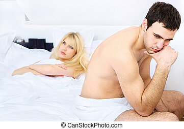 relationship difficulties of a young couple in bedroom,...