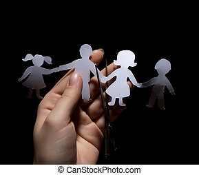 Paper chain family, divorce on black background