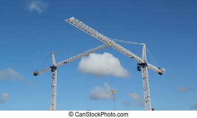 Two cranes. Two shots. Timelapse. - White tower cranes...