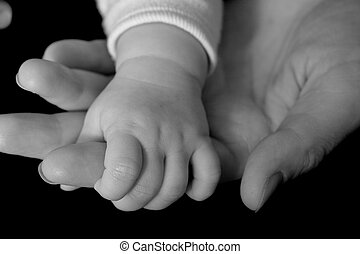 Help - Hand of baby in the adult hand