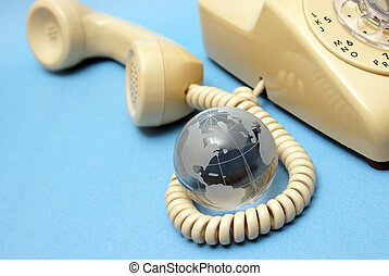 Global Communications - A globe and rotary phone represent...