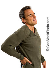 Back Pain Man - Man holds his back trying to relieve his...