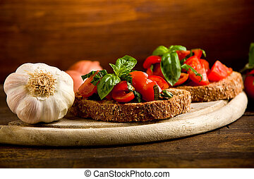 Bruschetta appetizer with fresh tomatoes - photo of...