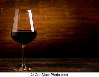 Wine - photo of delicious dark red wine goblet on wooden...