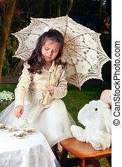 Drinking tea as Alice in Wonderland - Girl dressed as Alice...