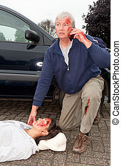 Calling for help - Wounded man calling for help after a car...