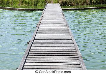 Wood bridge - Bridge walkway of the bridge in the water to...