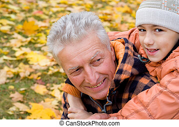 grandfather and kid - portrait of a grandfather with child...