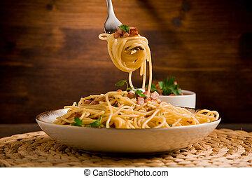 Pasta alla carbonara - Delicious spaghetti with bacon and...