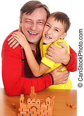 dad playing with son - portrait of a cute father playing...