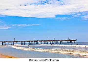 beach with old wooden pier