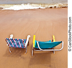 beach with two chairs for relaxing