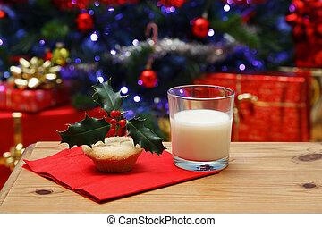 Glass of milk and a mince pie for Santa - Photo of a glass...