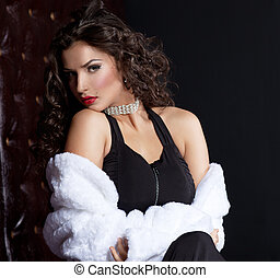 Sexy young woman posing in fur coat - sexy young woman lay...