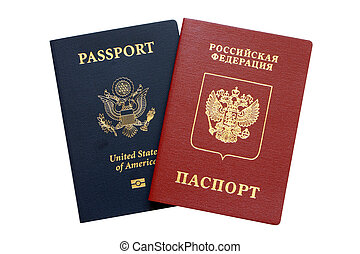 Russian and American passports isolated on a white...