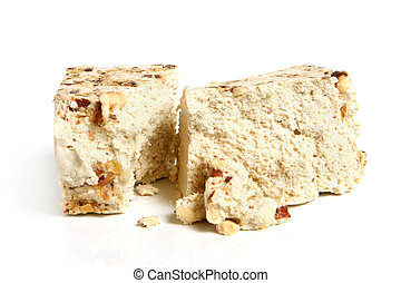 Halva with nuts on a white background