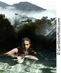 Man bathing in tropical waters