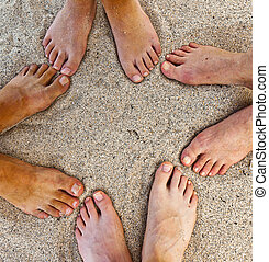 feet of family at the beach