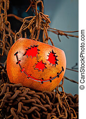 Halloween pumkin cought in the web of chains