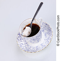 cup of coffee with a spoon of sugar
