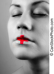 Black and white ohoto of a girl with medical lipstick