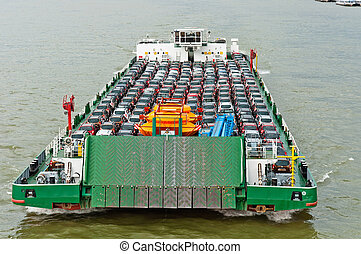 Tanker with a lot of cars carried to the market