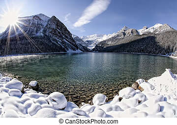 Lake Louise Winter Wonderland - Sun shining over Lake...