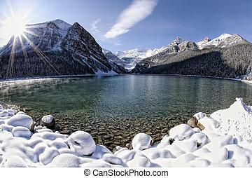 Lake Louise Winter Wonderland - Sun shining over Lake...