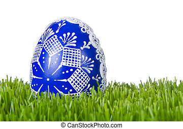 easter egg in grass - decorated easter egg in the grass