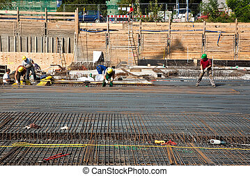 workers are doing the armoring at the building site to...