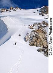 Group of climbers on winter mountains - Winter mountains...