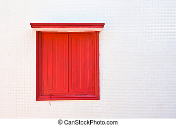 Red window on white wall