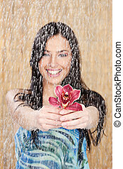 Happy girl with red orchid under water drops - Happy girl...