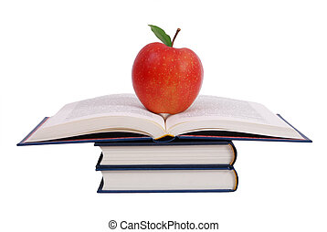 Books tower with apple isolated on white background