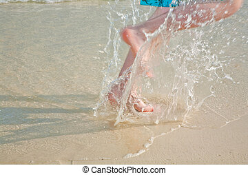 running feet at the beach
