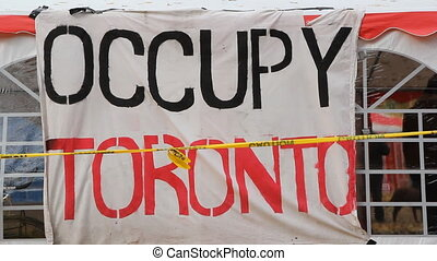 Occupy Toronto sign. - Occupy Toronto sign and tent. Two...