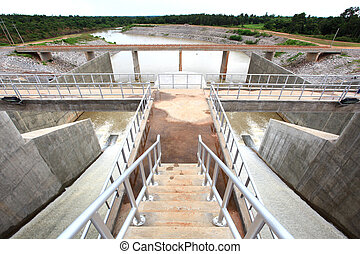 water gates at dam - Water pouring through the water gates...