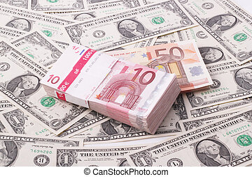 wads - A wad of 10, 50 Euro bills on one-dollar bills