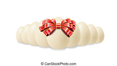 Chicken eggs for Easter. - Chicken eggs and red bow are...