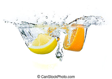 fruit splashing - sliced citrus fruit with kiwi splashing...