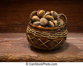 Almonds basket - Basket full of almonds on a wooden...