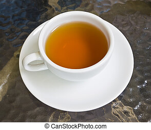 cup of tea on glass table