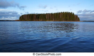Forest island on a lake in Finland