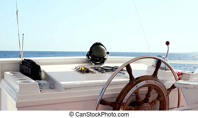 Wheel boat - View from boat wheelhouse on a sea and blue...
